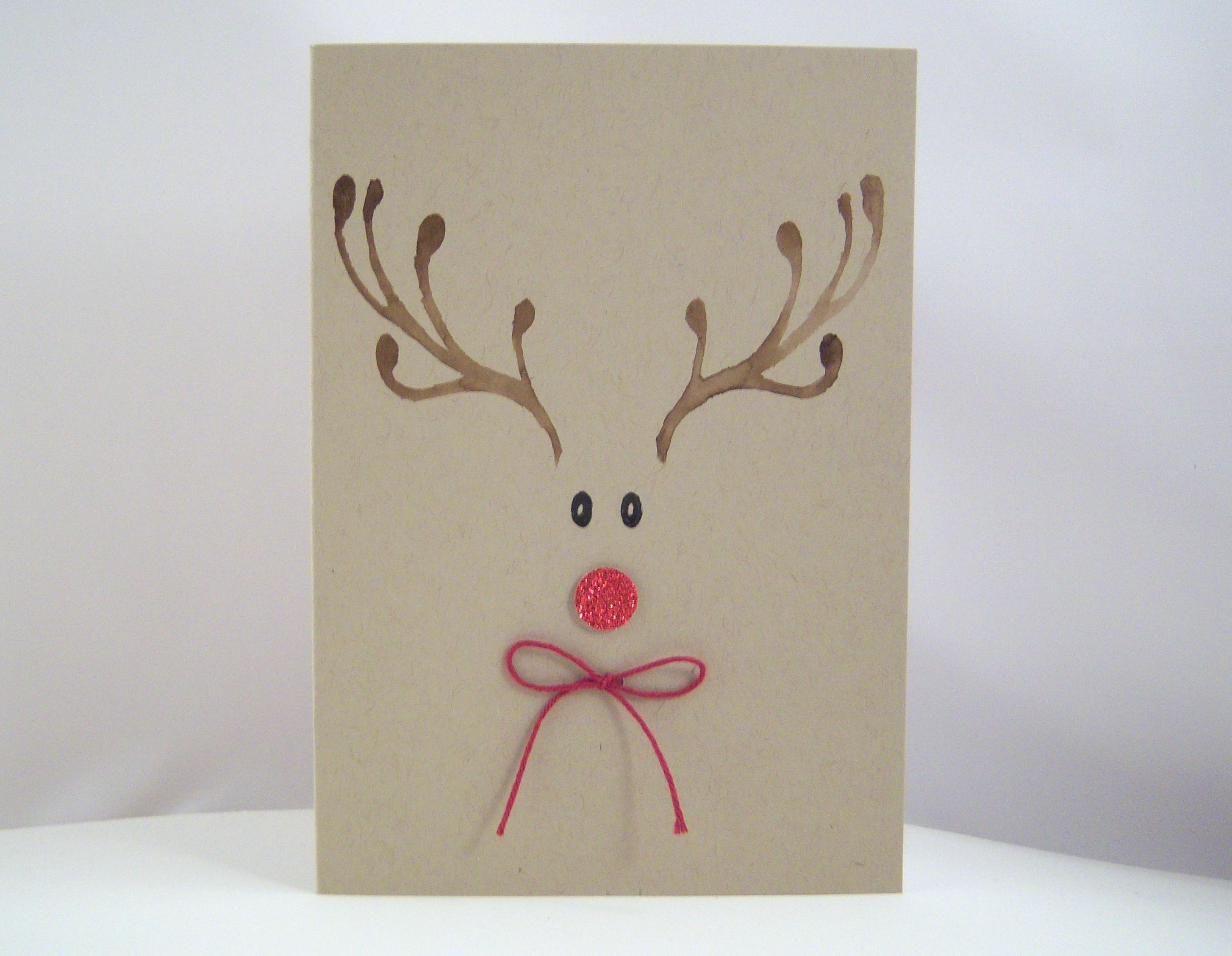 Weihnachten - Weihnachtskarte -Rentiergesicht mit Schleife- Bild 1